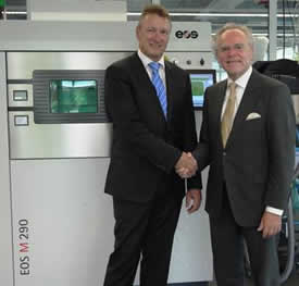 From left to right: Pascal Boillat, Head of GF Machining Solutions with Dr. Hans J. Langer, Founder and CEO EOS Group in front of an EOS M 290 metal Additive Manufacturing system  (Photo courtesy of EOS)